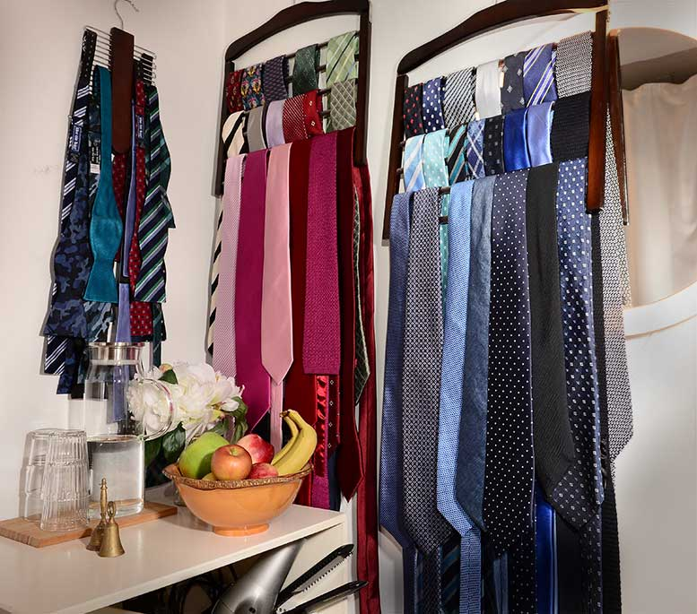 Jom's studio's rack of blue,other colours, and bow ties. You are most welcome to borrow them for no charge.